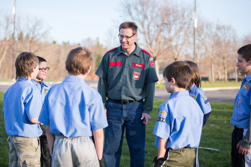 Brigade Leader mentoring and discipling young boys in stockade (wearing uniforms)