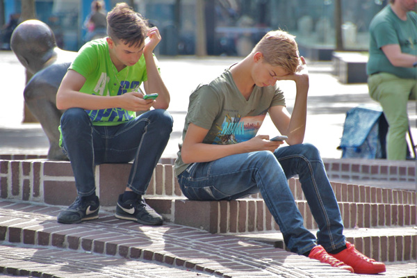 Boys using mobile devices are exposed in real time to challenging cultural input